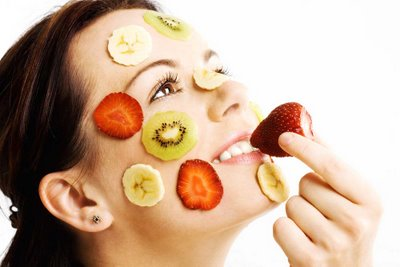 Beauty of Food Woman with Fruits on Face
